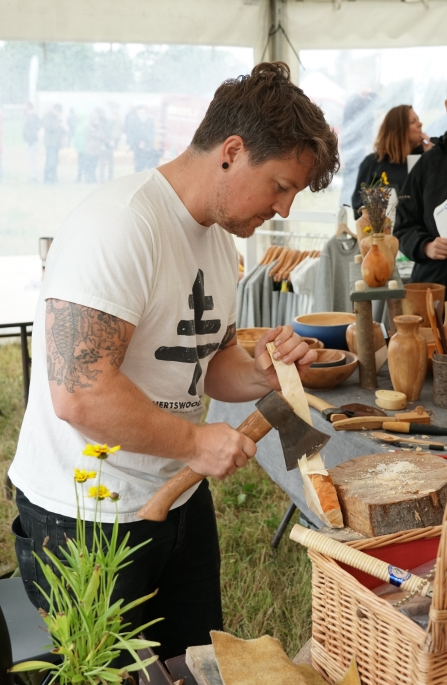 Jonah from Herts Wood carving a spoon